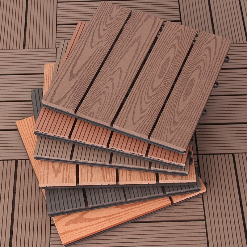 Composite deck tile with wood grain